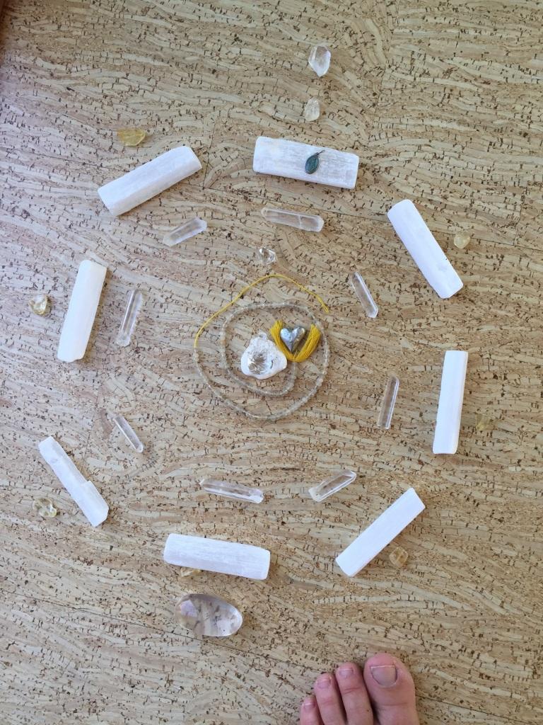 Here is my full moon crystal grid... It has Lemurian seed quartz, citrine, selinite, a Quartz Ganesha, Herkimer Diamond & all sorts of powerful intention.