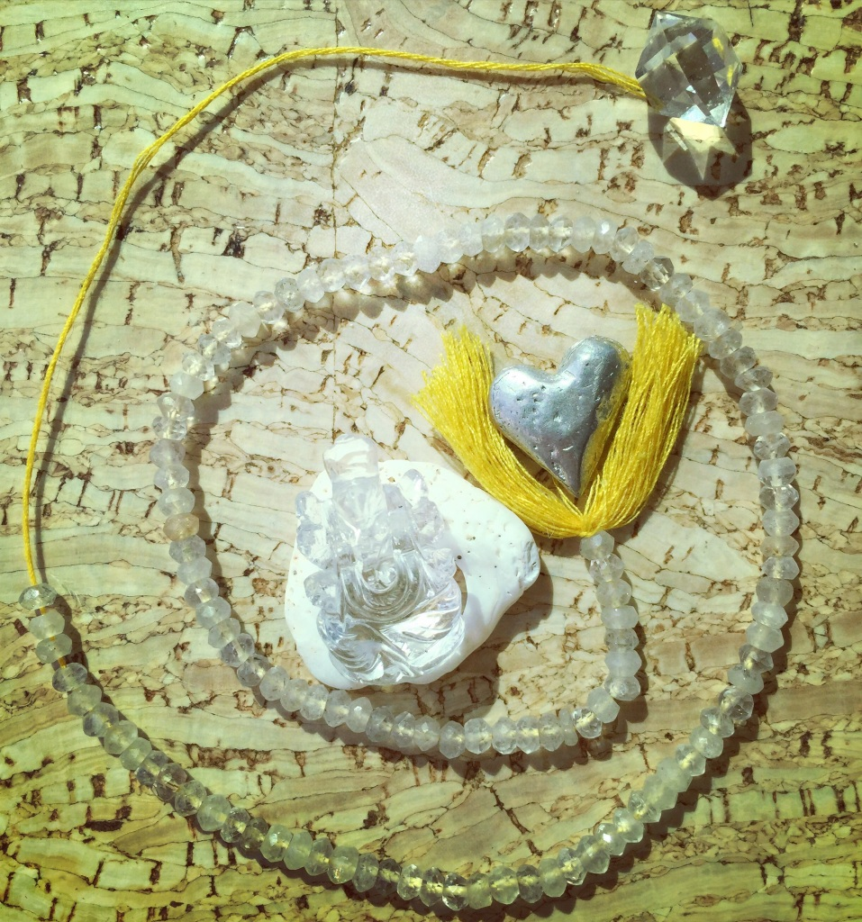 Here is what I call the heart of my crystal grid... ❤️✨... It has citrine beads, a shell, a crystal Ganesha & a Herkimer diamond.